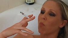 Busty blonde amateur milf julia ann smokes her cigs soaking in tub